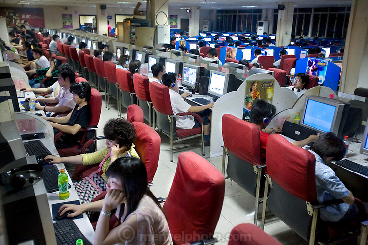 Ming Wang Internet cafe in Shanghai, China, where extreme gamer Xu Zhipeng rents a chair for six months at a time and continuously plays games. (From the book What I Eat: Around the World in 80 Diets.) His longest continuous game lasted three days and nights. China has more than 300 million Internet users?a number close to the entire population of the United States.