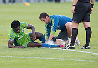 August 10, 2013: Seattle Sounders FC forward Obafemi Martins #9 lis attended to by the trainer during an MLS regular season game between the Seattle Sounders and Toronto FC at BMO Field in Toronto, Ontario Canada.<br /> Seattle Sounders FC won 2-1.