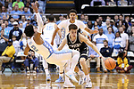 CHAPEL HILL, NC - DECEMBER 20: Wofford's Nathan Hoover (10) runs into North Carolina's Joel Berry II (2). The University of North Carolina Tar Heels hosted the Wofford College Terriers on December 20, 2017 at Dean E. Smith Center in Chapel Hill, NC in a Division I men's college basketball game. Wofford won the game, upsetting UNC, 79-75.