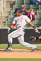 Jose Garcia #36 of the Greenville Drive follows through on his swing against the Kannapolis Intimidators at Fieldcrest Cannon Stadium on May 8, 2011 in Kannapolis, North Carolina.   Photo by Brian Westerholt / Four Seam Images