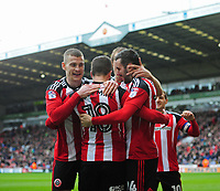 Sheffield United's Danny Lafferty, right, celebrates scoring his sides second goal with team-mates, from left, Paul Coutts, Kieron Freeman and James Hanson<br /> <br /> Photographer Chris Vaughan/CameraSport<br /> <br /> The EFL Sky Bet League One - Sheffield United v Charlton Athletic - Saturday 18th March 2017 - Bramall Lane - Sheffield<br /> <br /> World Copyright &copy; 2017 CameraSport. All rights reserved. 43 Linden Ave. Countesthorpe. Leicester. England. LE8 5PG - Tel: +44 (0) 116 277 4147 - admin@camerasport.com - www.camerasport.com