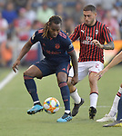 Renato Sanches (35, left) of Bayern Munich vies with Davide Calabria (2) of Milan for the ball during their International Champions Cup match on July 23, 2019 at Children's Mercy Park in Kansas City, KS.<br /> Tim VIZER/AFP