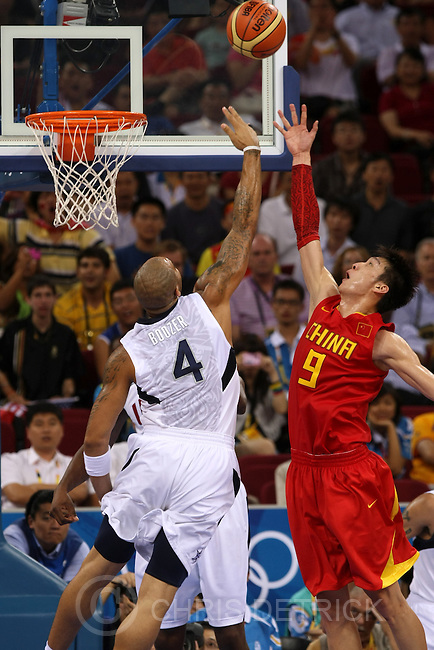 USA's Carlos Boozer shoots over China's Sun Yue during the game at the Olympic Basketball Gymnasium in Beijing, Sunday, August 11, 2008. USA defeated Chian 101-70...Photo by Chris Detrick/The Salt Lake Tribune.