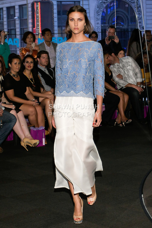 "Model walks runway in a light blue lace 3/4 top with white organza pants, from the Yuna Yang Spring Summer 2013 ""Close your eyes and see the world"" collection, at the NASDAQ Marketsite, during New York Fashion Week, on September 7, 2012."