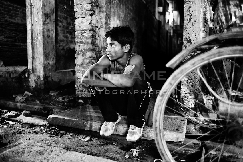 Al-Amin sets in front of the place where he lives, Khilgong, Dhaka, Bangladesh.