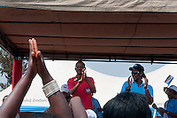 Rwandan president Paul Kagame claps to a song during the presidential campaign rally in Gisagara District, Rwanda. July 28 2010