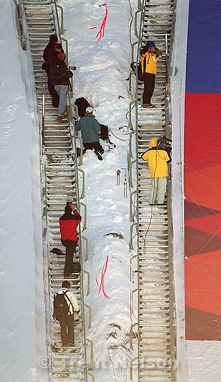 Photographers on the ski-jump hill at the FIS World-Cup Ski-Jumping Individual K120 competition.<br />