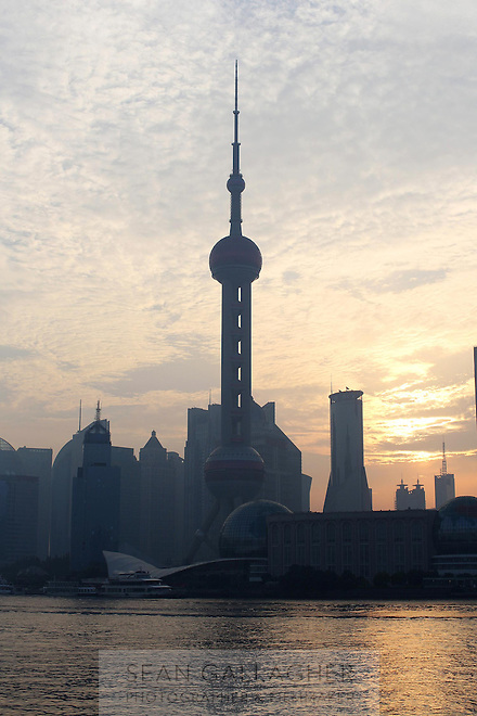 The Oriental Pearl Tower and skyline lit by the early morning sun, 2014.<br />