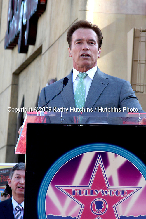 Arnold Schwarzenegger. at the Hollywood Walk of Fame Ceremony for James Cameron.Egyptian Theater Sidewalk.Los Angeles,  CA.December 18, 2009.©2009 Kathy Hutchins / Hutchins Photo.