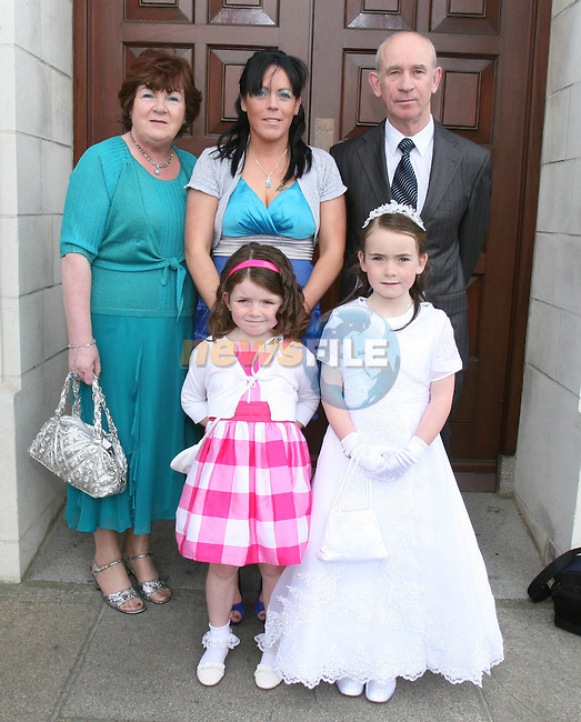 Kathlyn, Chloe, Kathleen, Fiona and Noel Carter at St Brigid's NS Communion in the Lourdes Church....Photo NEWSFILE/Jenny Matthews.(Photo credit should read Jenny Matthews/NEWSFILE)....This Picture has been sent you under the condtions enclosed by:.Newsfile Ltd..The Studio,.Millmount Abbey,.Drogheda,.Co Meath..Ireland..Tel: +353(0)41-9871240.Fax: +353(0)41-9871260.GSM: +353(0)86-2500958.email: pictures@newsfile.ie.www.newsfile.ie.FTP: 193.120.102.198.