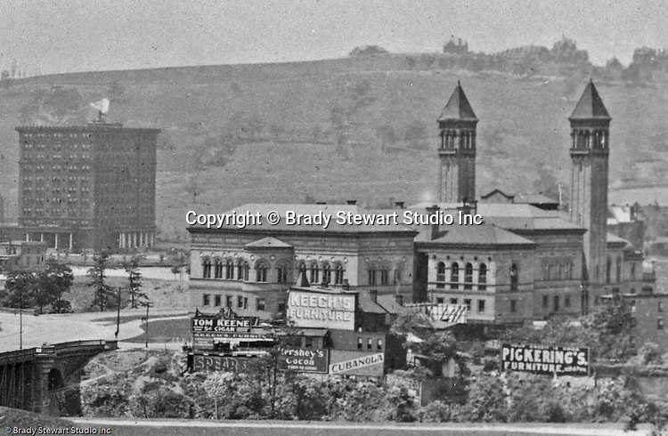 Building Advertising: Keech's Furniture, Hershey's Cocoa, Tom Keene Cigars, Pickerings Furniture, Cubanola sheet music and Red Raven Splits.<br /> <br /> Oakland Section of Pittsburgh:  View of Schenley Park, Schenley Bridge and the Carnegie Institute from Flagstaff Hill - 1907.  Image includes the statue of Edward Manning Bigelow, Director of Public Works, and the Electric Fountain, bottom of Flagstaff Hill.  The Carnegie Institute (Library) is located to the right across the St Pierre Ravine.  The image includes the Schenley Bridge which was built in 1897 by architect Henry Rust.