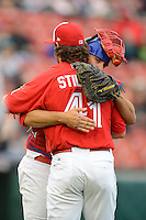 Buffalo Bisons catcher Mike Nickeas #11 hugs pitcher John Stilson #41 after the first game of a double header against the Lehigh Valley IronPigs on June 7, 2013 at Coca-Cola Field in Buffalo, New York.  Buffalo defeated Lehigh Valley 4-3.  (Mike Janes/Four Seam Images)