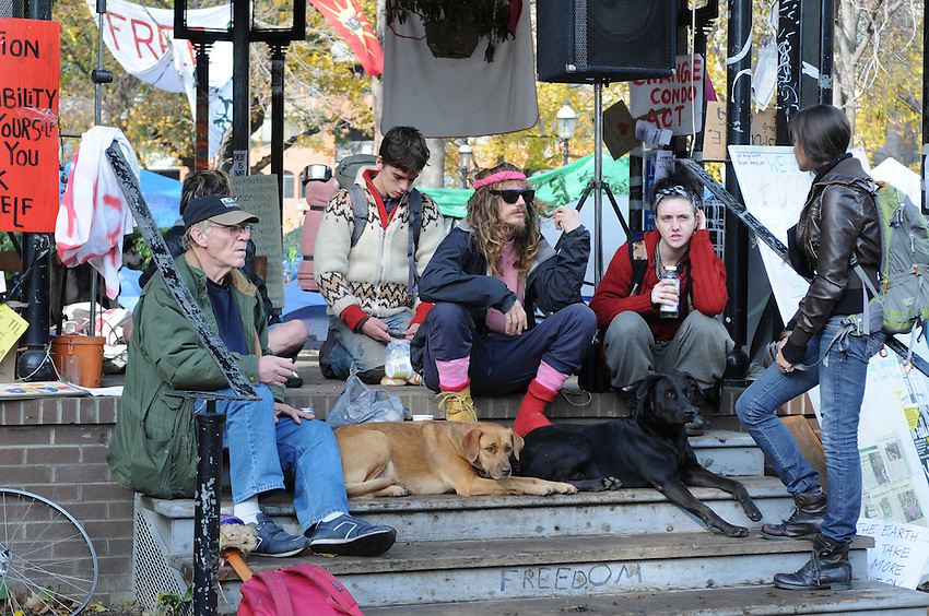 Morning of November 15, 2011, five members of the Occupy Toronto Protest at the Tent Camp at St. James Park, one month in.  This morning the protesters were served eviction notices requiring them to vacate the park by 12:01am November 16, 2011.