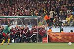 19 JUN 2010: Denmark head coach Morten Olsen (DEN) (far right) and the Denmark technical staff watch play. The Denmark National Team defeated the Cameroon National Team 2-1 at Loftus Versfeld Stadium in Tshwane/Pretoria, South Africa in a 2010 FIFA World Cup Group E match.