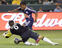 LA Galaxy GK Steve Cronin (0) makes a save from New York Red Bulls FWD Dane Richards (19). The LA Galaxy defeated the New York Red Bulls 3-1 in OT during a US Open Cup qualifier at the Home Depot Center in Carson, California, May 8, 2007.