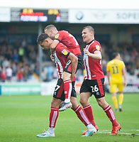 Lincoln City's Tyler Walker, left, celebrates scoring his side's second goal with team-mates Jack Payne, centre and Harry Anderson<br /> <br /> Photographer Andrew Vaughan/CameraSport<br /> <br /> The EFL Sky Bet League One - Lincoln City v Fleetwood Town - Saturday 31st August 2019 - Sincil Bank - Lincoln<br /> <br /> World Copyright © 2019 CameraSport. All rights reserved. 43 Linden Ave. Countesthorpe. Leicester. England. LE8 5PG - Tel: +44 (0) 116 277 4147 - admin@camerasport.com - www.camerasport.com