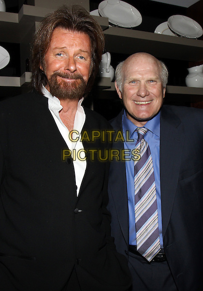 RONNIE DUNN & TERRY BRADSHAW (pro football hall-of-famer).At the Honors Gala benefiting the T.J. Martell Foundation held at the Hutton Hotel, Nashville, TN, USA..March 22nd, 2010.half length black suit jacket stripe tie blue shirt beard facial hair .CAP/ADM/DH.©Dan Harr/AdMedia/Capital Pictures.