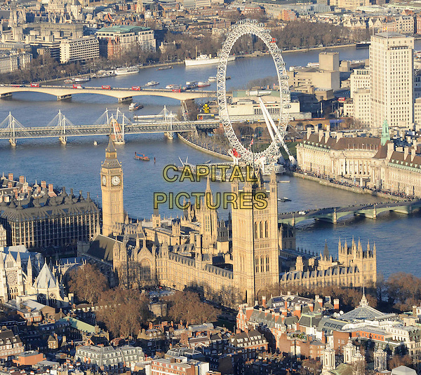 ATMOSPHERE .Aerial view over Westminster, London, England, UK, February 7th 2011..gv g.v. general view landmark Millenium wheel Houses of parliament Big Ben river Thames bridge city travel exterior from the air above building .CAP/FIN.©Steve Finn/Capital Pictures.