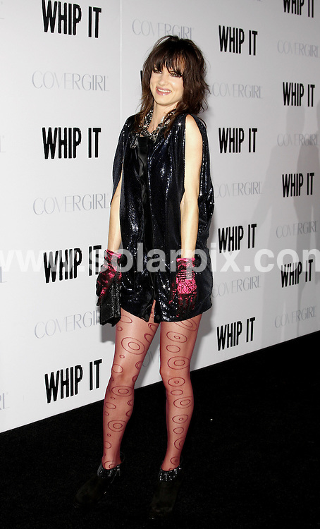 """**ALL ROUND PICTURES FROM SOLARPIX.COM**.**SYNDICATION RIGHTS FOR UK, AUSTRALIA, DENMARK, PORTUGAL, S. AFRICA, SPAIN & DUBAI (U.A.E) ONLY**.Arrivals for the """"Whip It"""" Los Angeles Premiere at the Grauman's Chinese Theater, Hollywood, CA, USA. 29 September 2009..This pic: Julliette Lewis..JOB REF: 10038 PHZ (Ortega)    DATE: 29_09_2009.**MUST CREDIT SOLARPIX.COM OR DOUBLE FEE WILL BE CHARGED**.**MUST NOTIFY SOLARPIX OF ONLINE USAGE**.**CALL US ON: +34 952 811 768 or LOW RATE FROM UK 0844 617 7637**"""