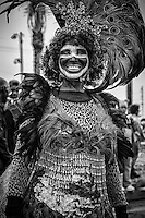 A member of the Zulu Social Aid & Pleasure Club prepares to march in the 'Zulu Parade' on Jackson Avenue, the first parade on the morning of Mardi Gras Day on February 12, 2013 in New Orleans, Louisiana.