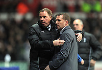 Pictured L-R: Harry Redknapp manager for Tottenham Hotspur withBrendan Rodgers manager for Swansea. Saturday 31 December 2011<br />