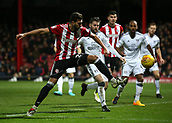 2nd December 2017, Griffen Park, Brentford, London; EFL Championship football, Brentford versus Fulham; Yoann Barbet of Brentford with an attempted shot for goal