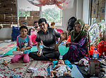 28 August 2019, Jakarta, Indonesia: - Afghan baby Mehran, just 40 days old, with her mother, Khadija Hussani (31), father <br /> Yassin Husssani and sister Fatima (10) inside their shared room at the UNHCR refugee centre in Kalideres, Jakarta. Plans to re-locate the overcrowded refugees have been fast tracked after a fight broke out between the groups, many of whom have been in Indonesia for years waiting for placement. Tensions ran high between Afghan and African groups in the centre with a lack of adequate food for the refugees being the catalyst. The African groups, who were moved onto the footpath, were being bussed out today. Conditions in the centre are grim and the local Indonesian population not happy with the refugees presence in the suburb.Picture by Graham Crouch/The Australian