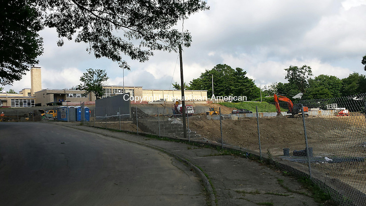 WATERBURY -- Contractors have begun preparing the grounds behind Kennedy School for a 40,500-square-foot addition.