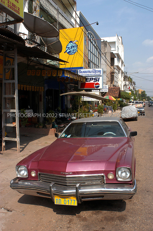 5/8/2003--Vientiane, Laos..An American car parked on the streets of Luang Prabang, left over from the War...All photographs ©2003 Stuart Isett.All rights reserved.This image may not be reproduced without expressed written permission from Stuart Isett.