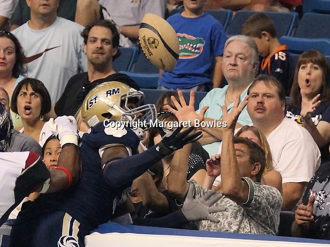 05 June 2010: Tampa Bay wide receiver Hank Edwards fights a fan for the ball.   The Tampa Bay Storm defeated the Oklahoma City Yard Dawgz 50-48 at the St. Pete Forum in Tampa, Florida