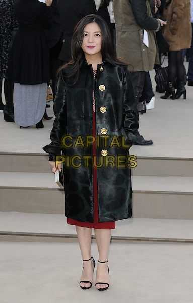 Vicki Zhao.attended the Burberry Prorsum London Fashion Week a/w 2013 catwalk show, Kensington Gardens, Hyde Park, London, England..February 18th, 2013.LFW full length black coat gold buttons hand in pocket .CAP/CAN.©Can Nguyen/Capital Pictures.