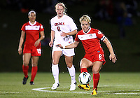 BOYDS, MARYLAND - April 06, 2013:  Lori Lindsey (6) of The Washington Spirit  passes the ball in front of of Makenzy Doniak (9) of the University of Virginia women's soccer team in a NWSL (National Women's Soccer League) pre season exhibition game at Maryland Soccerplex in Boyds, Maryland on April 06. Virginia won 6-3.