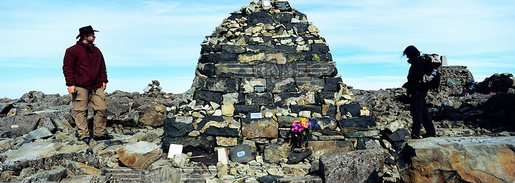 At the summit of Ben Nevis, Britain's highest mountain. Thousands of visitors reach the peak each year, where a ruined observatory and features constructed from the volcanic rocks serve as memorials for walkers and climbers who have perished on the mountainside. .