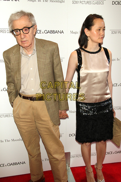 NEW YORK, NY - JULY 17: Woody Allen and Soon Yi at the 'Magic In The Moonlight' premiere at the Paris Theater on July 17, 2014 in New York City.  <br /> CAP/MPI/RW<br /> &copy;RW/ MediaPunch/Capital Pictures