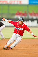 Chace Numata (2) of the Lakewood BlueClaws puts on the brakes as he rounds second base during the South Atlantic League game against the Kannapolis Intimidators at CMC-Northeast Stadium on August 13, 2013 in Kannapolis, North Carolina.  The Intimidators defeated the BlueClaws 12-8.  (Brian Westerholt/Four Seam Images)