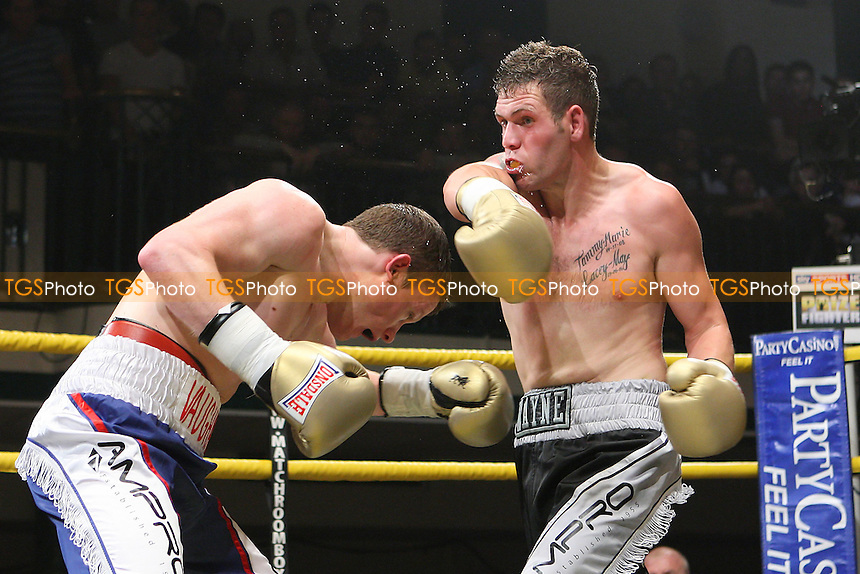 Peter Vaughan (blue/white shorts) defeats Wayne Goddard (grey/black shorts) in Quarter-Final Two of Prizefighter The Light-Middleweights II at York Hall, Bethnal Green, promoted by Matchroom Sports - 15/09/11 - MANDATORY CREDIT: Gavin Ellis/TGSPHOTO - Self billing applies where appropriate - 0845 094 6026 - contact@tgsphoto.co.uk - NO UNPAID USE.