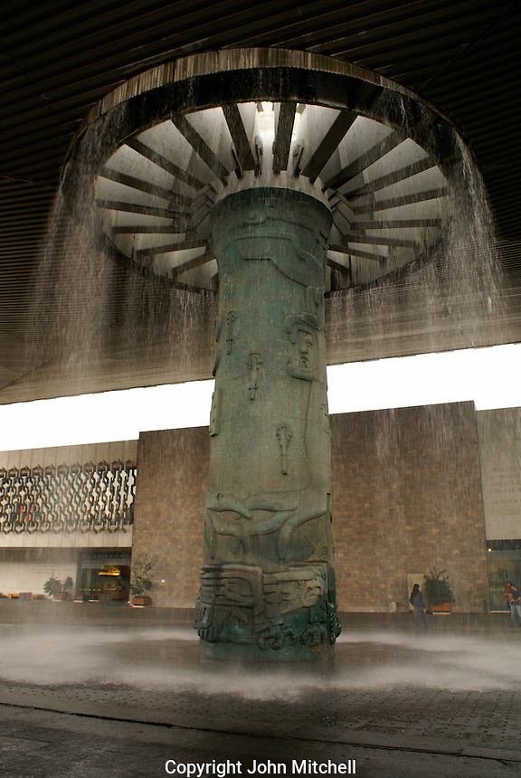 Stone fountain designed by Jose Chavez Morado in the courtyard of the Museo Nacional de Antropologia or National Musem of Anthropology in Chapultepec Park, Mexico City. This building was designed by Mexican architect Ramirez Vazquez during the 1960's, and it is considered to be one of the finest museums of its kind in the world.