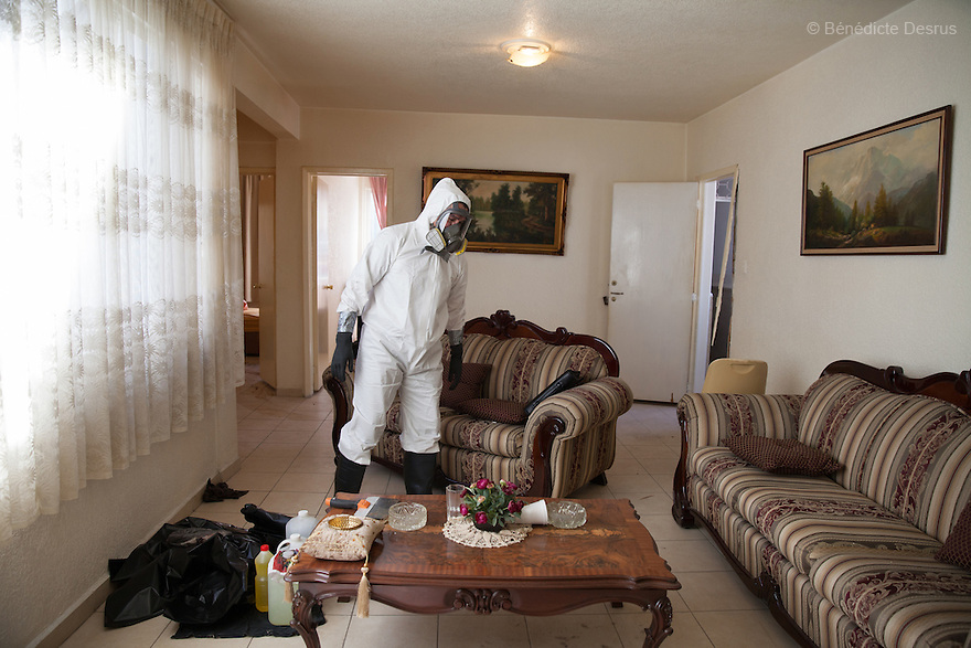 "Donovan carries out a forensic cleaning in Mexico City, Mexico on January 14, 2016. The decomposed body of a man in his 50s was found on the floor of his mother's bedroom, days after he had died of an intestinal obstruction. Because of her physical disability, the mother of the deceased – who had been her caregiver – was unable to move enough to make an emergency call. As a consequence, she was trapped in the room for three days with the body of her son – and without food or water - before help arrived. Donovan Tavera, 43, is the director of ""Limpieza Forense México"", the country's first and so far the only government-accredited forensic cleaning company. Since 2000, Tavera, a self-taught forensic technician, and his family have offered services to clean up homicides, unattended death, suicides, the homes of compulsive hoarders and houses destroyed by fire or flooding. Despite rising violence that has left 70,000 people dead and 23,000 disappeared since 2006, Mexico has only one certified forensic cleaner. As a consequence, the biological hazards associated with crime scenes are going unchecked all around the country. Photo by Bénédicte Desrus"