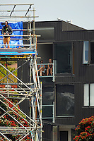 Fans watch from newly-constructed apartments during day one of the 2nd cricket test match between the New Zealand Black Caps and Sri Lanka at the Hawkins Basin Reserve, Wellington, New Zealand on Saturday, 3 February 2015. Photo: Dave Lintott / lintottphoto.co.nz