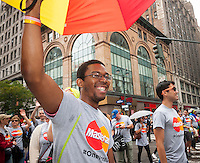 Mastercard employees and supporters march in the annual Lesbian, Gay, Bisexual and Transgender Pride Parade on Fifth Avenue in New York on Sunday, June 28, 2015. The parade was particularly boisterous due to the recent Supreme Court decision on same-sex marriage. The parade is the largest gay pride parade in the world.(© Richard B. Levine)