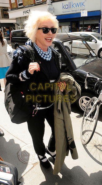 DEBBIE HARRY.Leaving BBC Radio 2, London, England..May 24th, 2011.full length sunglasses shades black jacket top blue beads necklace trousers mary janes shoes bag purse mouth open white socks .CAP/IA.©Ian Allis/Capital Pictures.