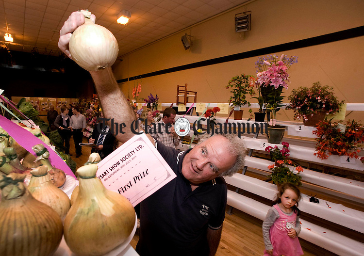 Getting a closer look at one of the prize winners during the horticultural exhibition at the Kildysart Show.