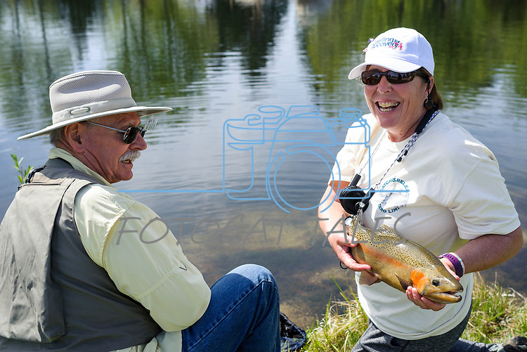 Ann Taylor displays the fish she caught with River Buddy George Liddell during the Casting for Recovery fishing clinic at Bently Ranch in Gardnerville, Nev. May 4, 2018.<br /> Photo by Candice Vivien/Nevada Momentum