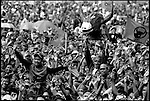 Summer '99-- Jakarta, Indonesia -- Megawati fans cheer her arrival at a rally..