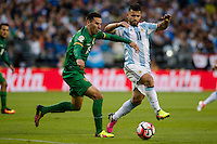 Seattle, WA - Tuesday June 14, 2016: Bolivia midfielder Alejandro Melean (13) looks to clear the ball past Argentina forward Sergio Aguero (11) during a Copa America Centenario Group D match between Argentina (ARG) and Bolivia (BOL) at CenturyLink Field