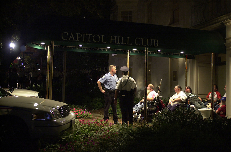 ADAPT2(TW)100400-- Members of ADAPT block the entrance to the Capitol Hill Club on debate night..They were protesting the GOP's non-support of the Americans with Disabilities Act.