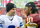 Dallas Cowboys quarterback Tony Romo (9) meets Washington Redskins quarterback Robert Griffin III following the game at FedEx Field in Landover, Maryland on Sunday, December 28, 2014.  The Cowboys won the game 44-17.<br /> Credit: Ron Sachs / CNP
