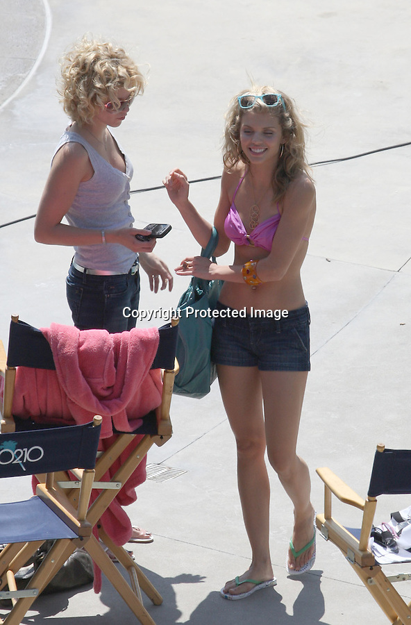 6-25-09.AnnaLynne McCord Anna Lynne Jessica Stroup & Jessica Lowndes eating ice cream laughing texting talking on cell phone while filming the tv show 90210 at a hotel pool in Huntington beach California wearing bikini tops ..  AbilityFilms@yahoo.com.805-427-3519.www.AbilityFilms.com.