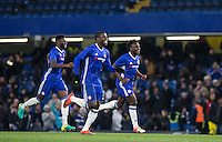 Kurt Zouma of Chelsea celebrates the penalty win with teammates during the The Checkatrade Trophy match between Chelsea U23 and Oxford United at Stamford Bridge, London, England on 8 November 2016. Photo by Andy Rowland.