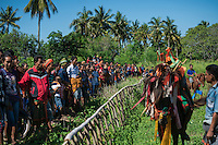 March 28, 2016 - Waiha (Indonesia). Spectators wait for the beginning of the second Pasola in the village of Waiha a few km outside Wainyapu. Even if considered by manys as a just training ahead of the big Pasola of Wainyapu, Waiha's festival is stills a good opportunity for the fighters to warm it up. © Thomas Cristofoletti / Ruom